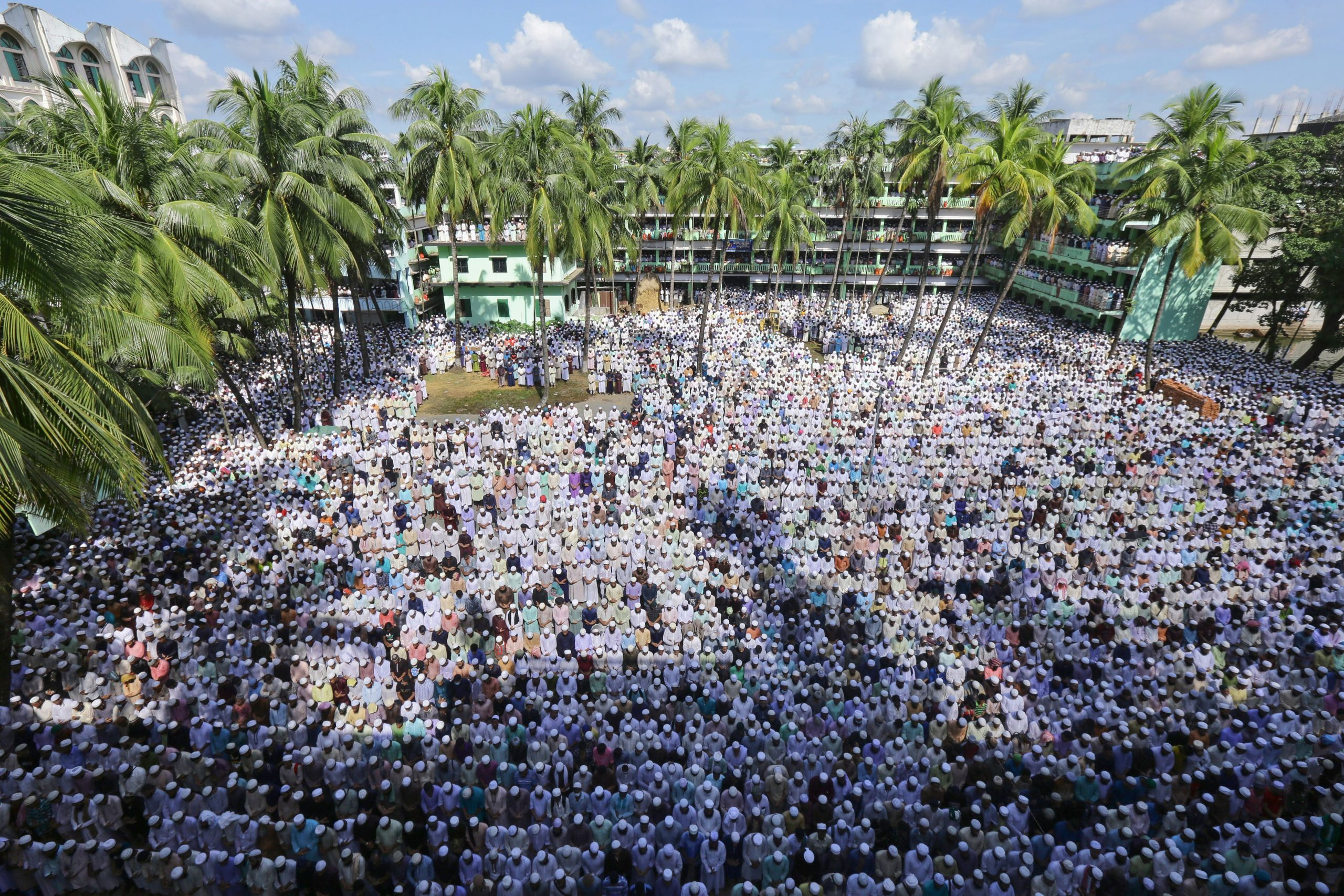 Followers of Allama Shah Ahmad Shafi, who had led the hardline Hefazat-e-Islam group, offer his funeral prayers, in Chittagong on September 19, 2020. (Photo by STR/AFP via Getty Images)