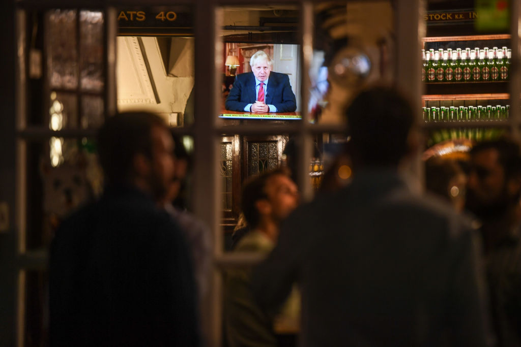 People watch British Prime Minister Boris Johnson making a televised address to the nation inside the Westminster Arms pub on September 22, 2020 in London.  (Photo: Peter Summers/Getty Images)