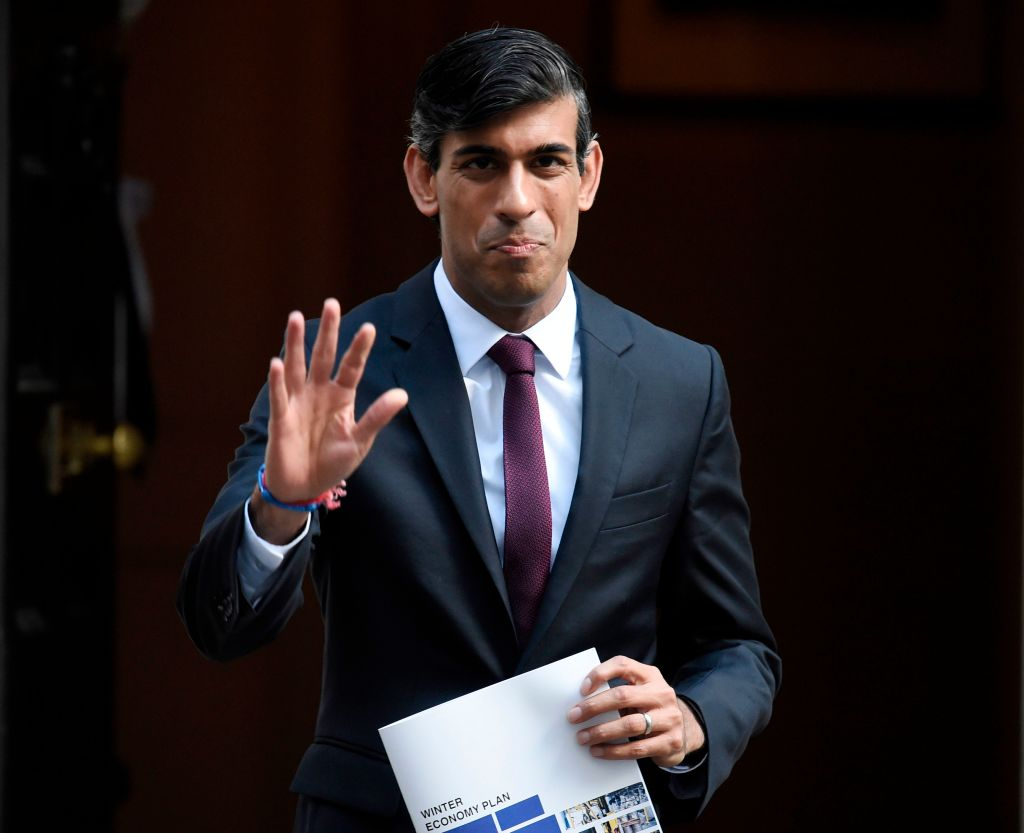 "Britain's Chancellor of the Exchequer Rishi Sunak poses with his 'Winter Economy Plan' outside 11 Downing street in central London on September 24, 2020. Finance Minister Rishi Sunak will unveil his ""Winter Economy Plan"" before parliament today, amid mounting fear that the end of his furlough jobs retention scheme next month could spark mass unemployment. (Photo by DANIEL LEAL-OLIVAS/AFP via Getty Images)"