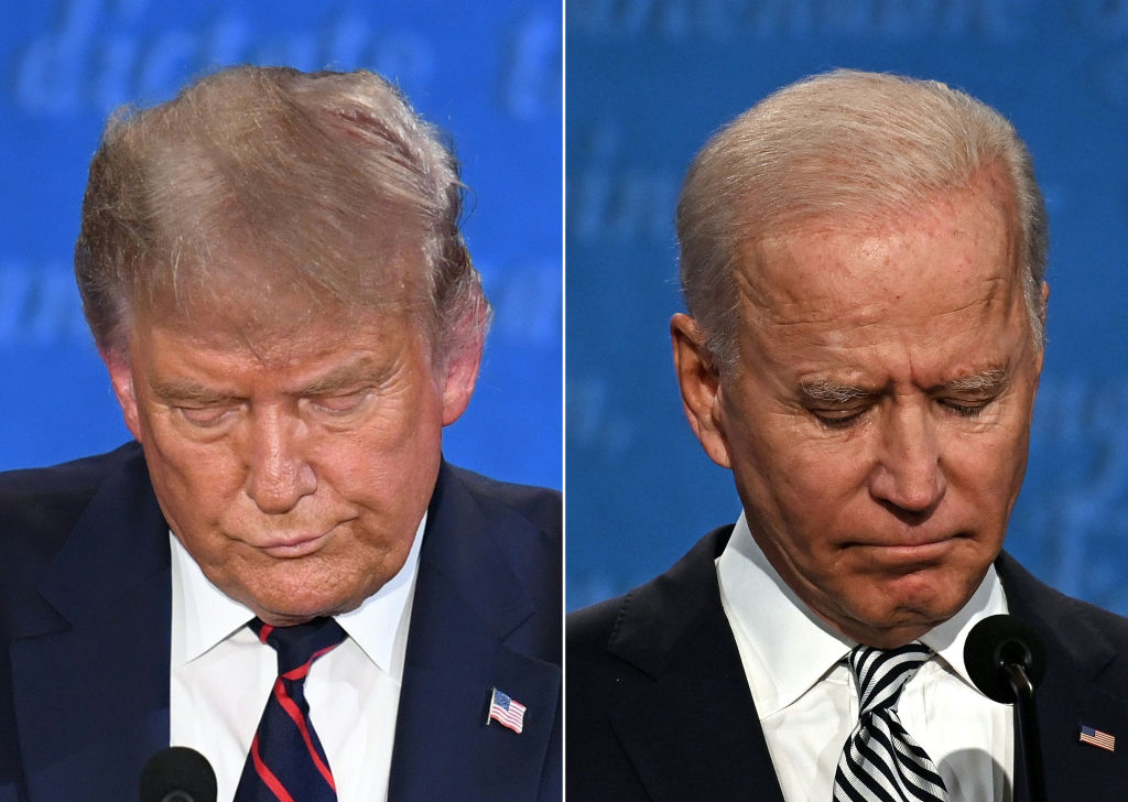 This combination of pictures created on September 29, 2020 shows US President Donald Trump (L) and Democratic Presidential candidate and former US Vice President Joe Biden during the first presidential debate at Case Western Reserve University and Cleveland Clinic in Cleveland, Ohio, on September 29, 2020. (Photo by SAUL LOEB,JIM WATSON/AFP via Getty Images)