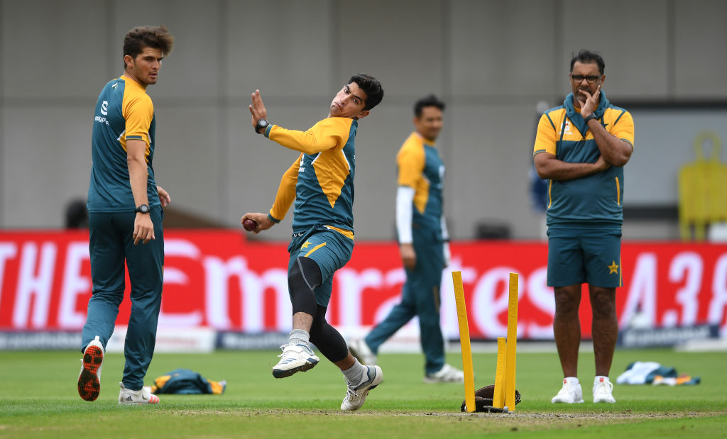 Nasim Shah of Pakistan bowls watched on by Shaheen Afridi and bowling coach Waqar Younis (extreme right) during a nets session the Old Trafford on August 04, 2020. (Photo: Gareth Copley/Getty Images)