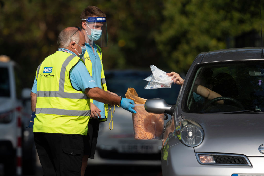 Workers collect swab tests from members of the public at a Covid Test site in South London on September 15, 2020 in Greater London, England. (Photo by Dan Kitwood/Getty Images)