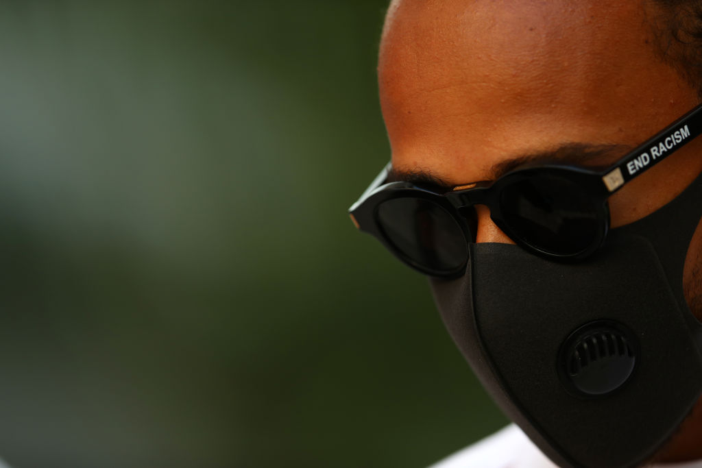 """Lewis Hamilton of Great Britain and Mercedes GP walks in the paddock sporting """"End Racism"""" sunglasses during previews ahead of the F1 Grand Prix of Russia at Sochi Autodrom on September 24, 2020 in Sochi, Russia. (Photo: Mark Thompson/Getty Images)"""