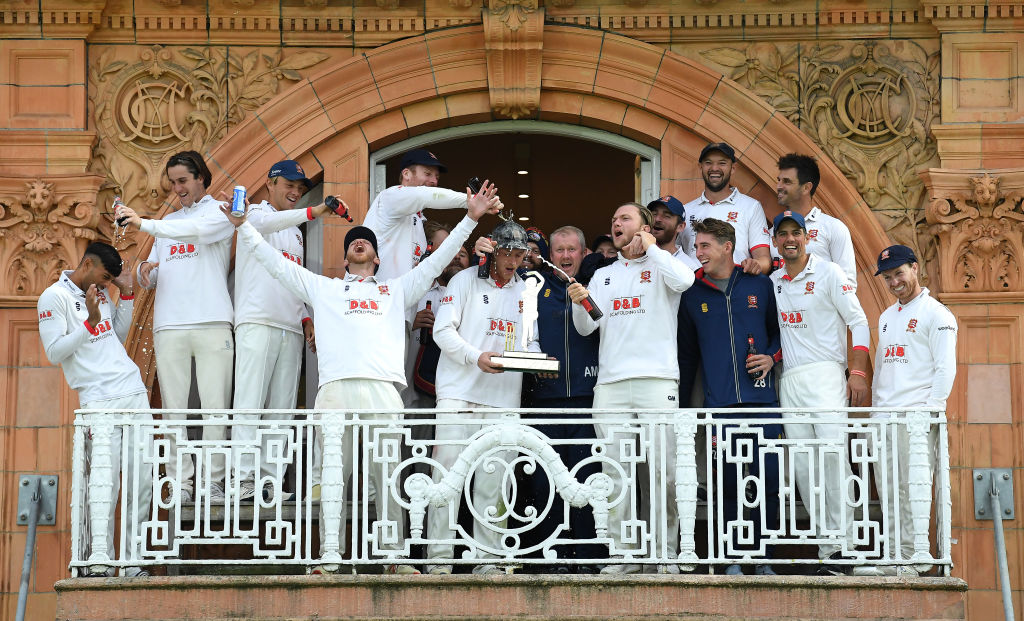 Essex captain Tom Westley holds the Bob Willis Trophy as he celebrates on the Pavilion balcony with his teammates and head coach Anthony McGrath during Day 5 of the Bob Willis Trophy Final between Somerset and Essex at Lord's Cricket Ground on September 27, 2020 in London, England. (Photo by Alex Davidson/Getty Images)