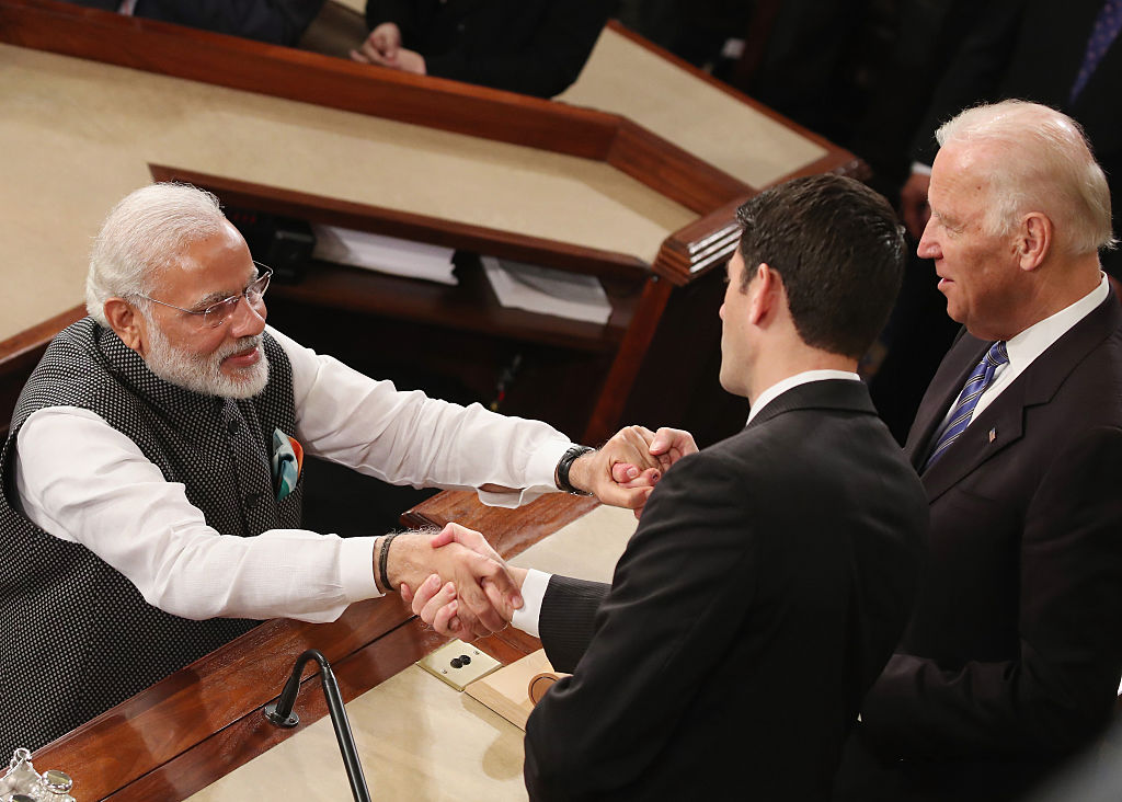 FILE PHOTO: Indian Prime Minister Narendra Modi, (L), shakes hands with then House Speaker Paul Ryan (R-WI), (C), and US Vice President Joseph Biden (R), after addressing a joint session of the United States Congress at the US Capitol, June 8, 2016 in Washington, DC. The Prime Minister has in town this week meeting with members of Congress, and President Barack Obama.  (Photo by Mark Wilson/Getty Images)
