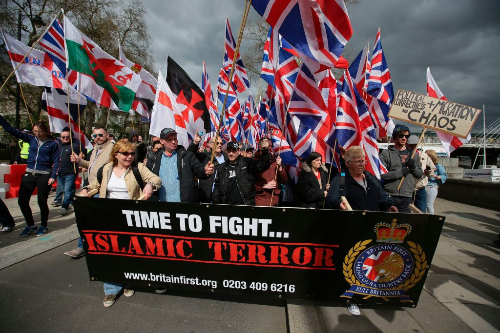FILE PHOTO: Members of the far-right group Britain First march with flags in central London on April 1, 2017 following the March 22 terror attack on the British parliament.  (Photo: DANIEL LEAL-OLIVAS/AFP via Getty Images)