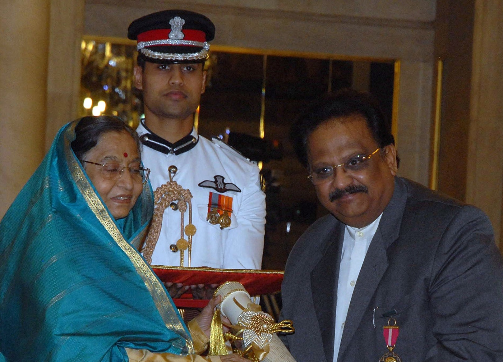 FILE PHOTO: Indian President Pradibha Singh Patil (L) presents Indian singer, S P Balasubrahmanyam during the presentation of the 'Padma Awards 2011' at The Presidential House in New Delhi on March 24, 2011.  (STRDEL/AFP via Getty Images)