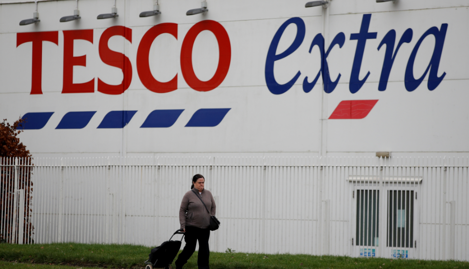 FILE PHOTO: A woman walks past a Tesco extra superstore near Manchester, Britain January 8, 2020. REUTERS/Phil Noble/File Photo