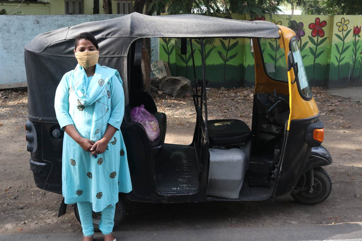 Talat Jahan, a domestic abuse survivor, poses for a photo next to her tuk-tuk in Bhopal India. Thomson Reuters Foundation/Handout by ActionAid