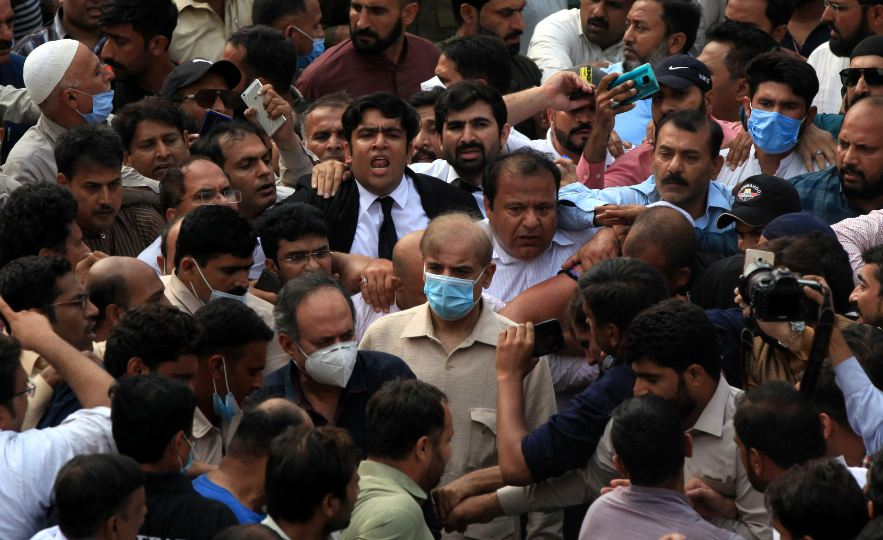 Shehbaz Sharif, brother of former Prime Minister Nawaz Sharif and leader of Pakistan Muslim League-Nawaz (PML-N), walks with lawyers and supporters after the High Court rejected bail plea in money laundering case in Lahore, Pakistan September 28, 2020. REUTERS/Mohsin Raza