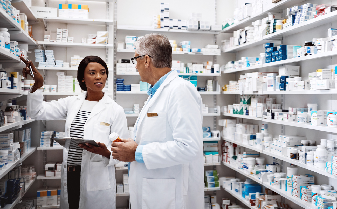 Shot of two pharmacists working together in a drugstore