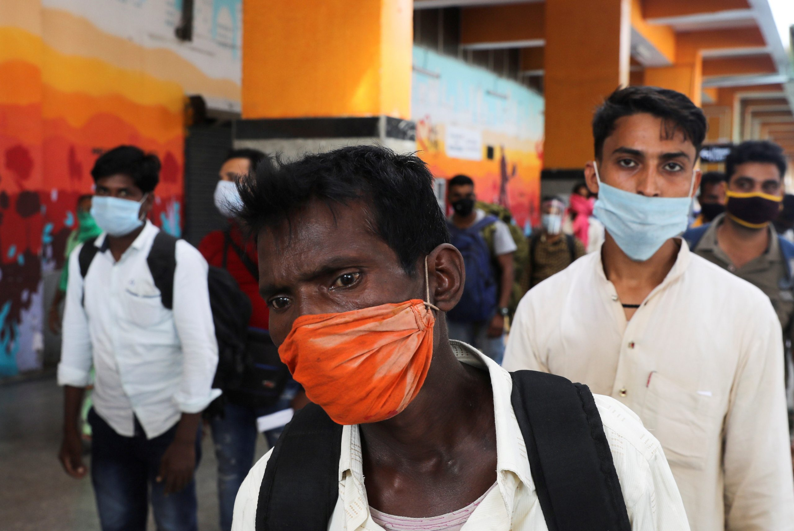 Passengers wearing protective face masks stand in a queue on a platform to get tested for the coronavirus disease (COVID-19), at a railway station, in New Delhi, India, October 5, 2020. REUTERS/Anushree Fadnavis/File Photo