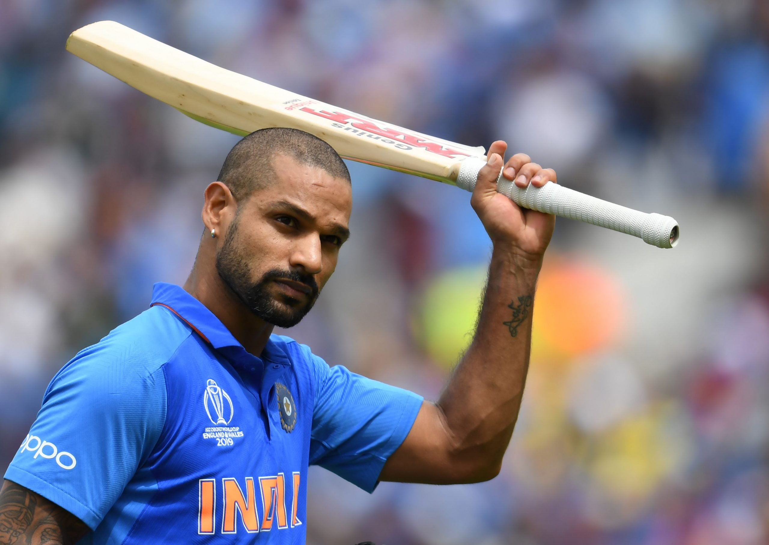 India's Shikhar Dhawan raises his bat to the crowd as he walks back to the pavilion after his dismissal during the 2019 Cricket World Cup group stage match between India and Australia at The Oval in London on June 9, 2019. (Photo by Dibyangshu SARKAR / AFP) / RESTRICTED TO EDITORIAL USE        (Photo credit should read DIBYANGSHU SARKAR/AFP via Getty Images)