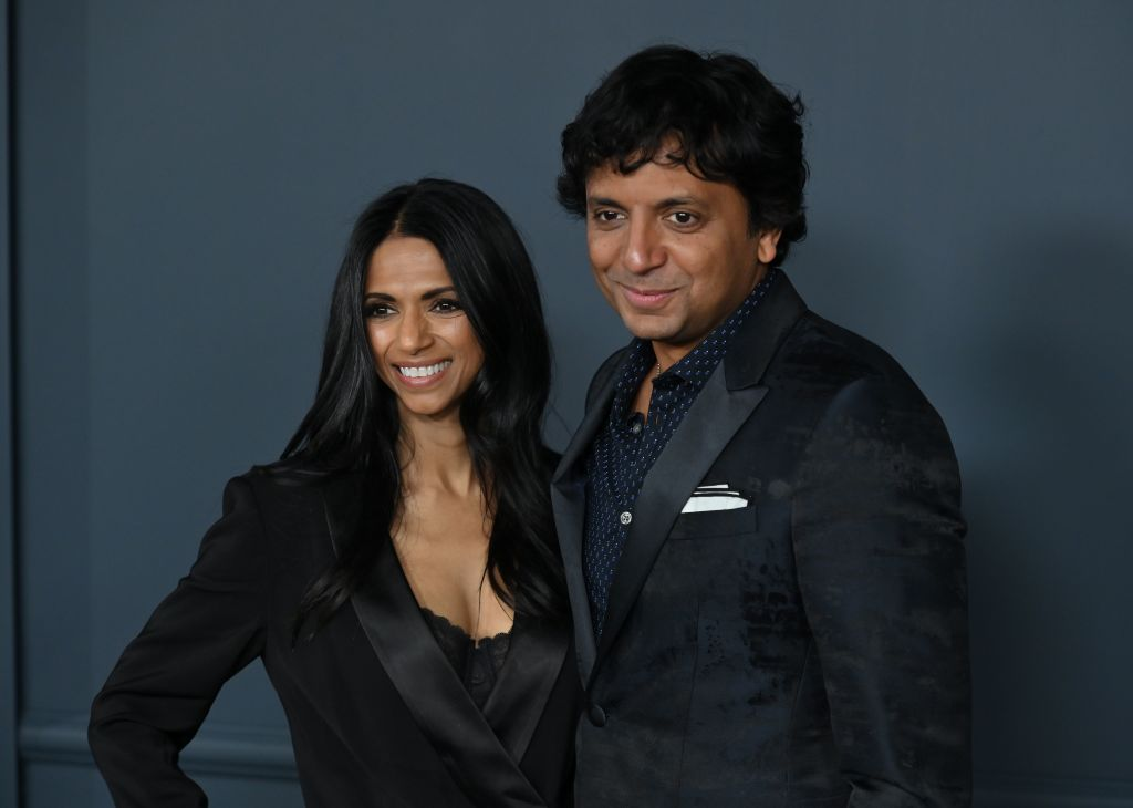 """FILE PHOTO: US filmmaker M Night Shyamalan and his wife Bhavna Vaswani arrive for Apple TV+ premiere of """"Servant"""" at BAM Howard Gilman Opera House in Brooklyn, New York on November 19, 2019. (Photo by ANGELA WEISS/AFP via Getty Images)"""