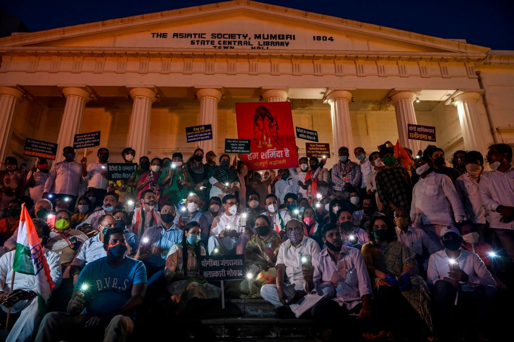 Political activists gather during a vigil following accusations of Indian Police forcibly cremating the body of a 19-year-old woman victim, who was allegedly gang-raped by four men in Bool Garhi village of Uttar Pradesh state, on the steps of the Asiatic Society in Mumbai on September 30, 2020. (Photo by INDRANIL MUKHERJEE/AFP via Getty Images)