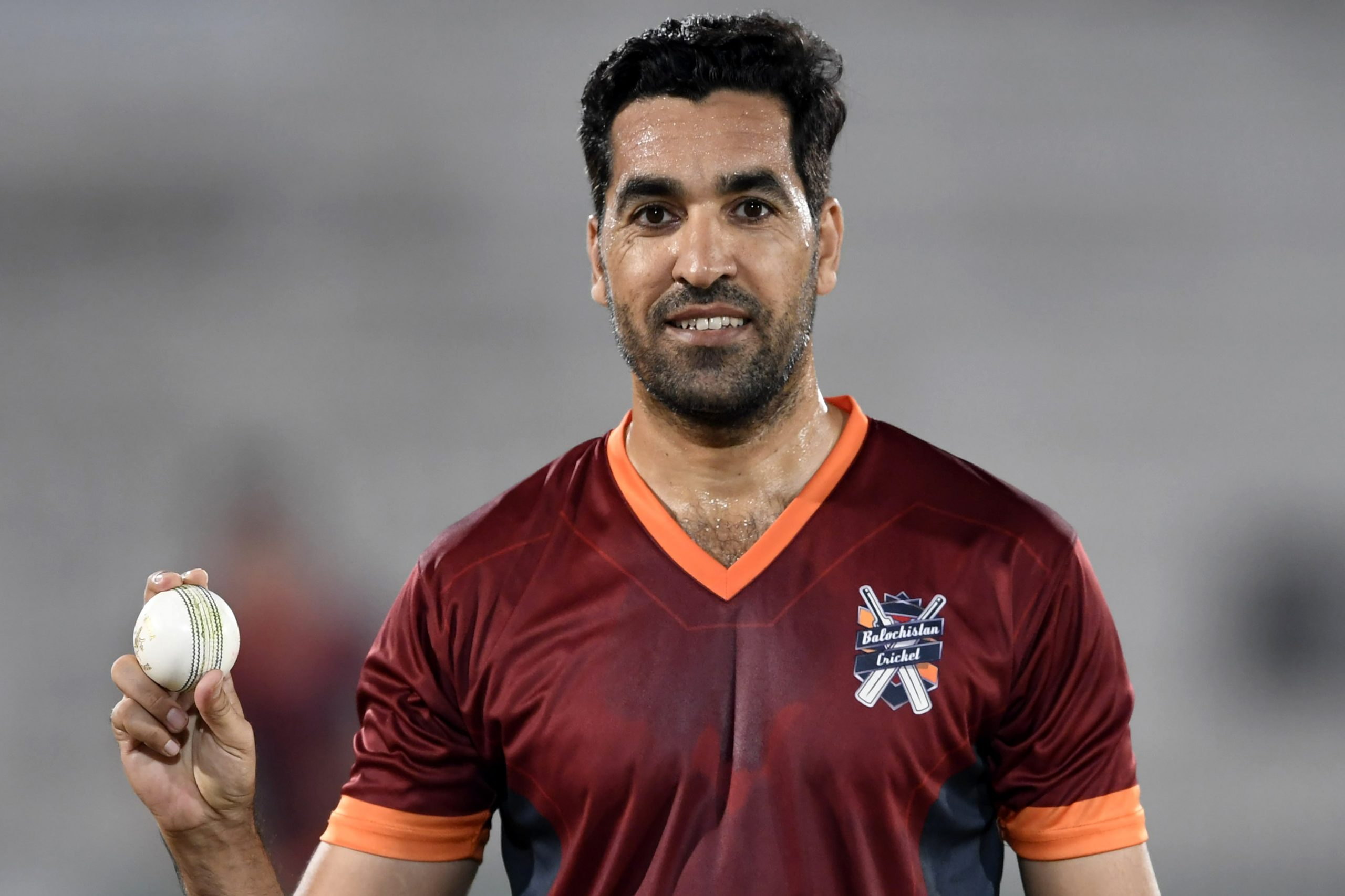 In this picture taken on October 16, 2020 Pakistani cricketer Umar Gul holds a ball before the start of a match during the National T20 Cup in Rawalpindi. - Pakistan bowler Umar Gul, who earned the nickname 'Gul-dozer' for his rattling of stumps, has called time on his 17-year cricket career. (Photo by Aamir QURESHI / AFP) / TO GO WITH 'cricket-Pak-Gul',FOCUS by SHAHID HASHMI (Photo by AAMIR QURESHI/AFP via Getty Images)