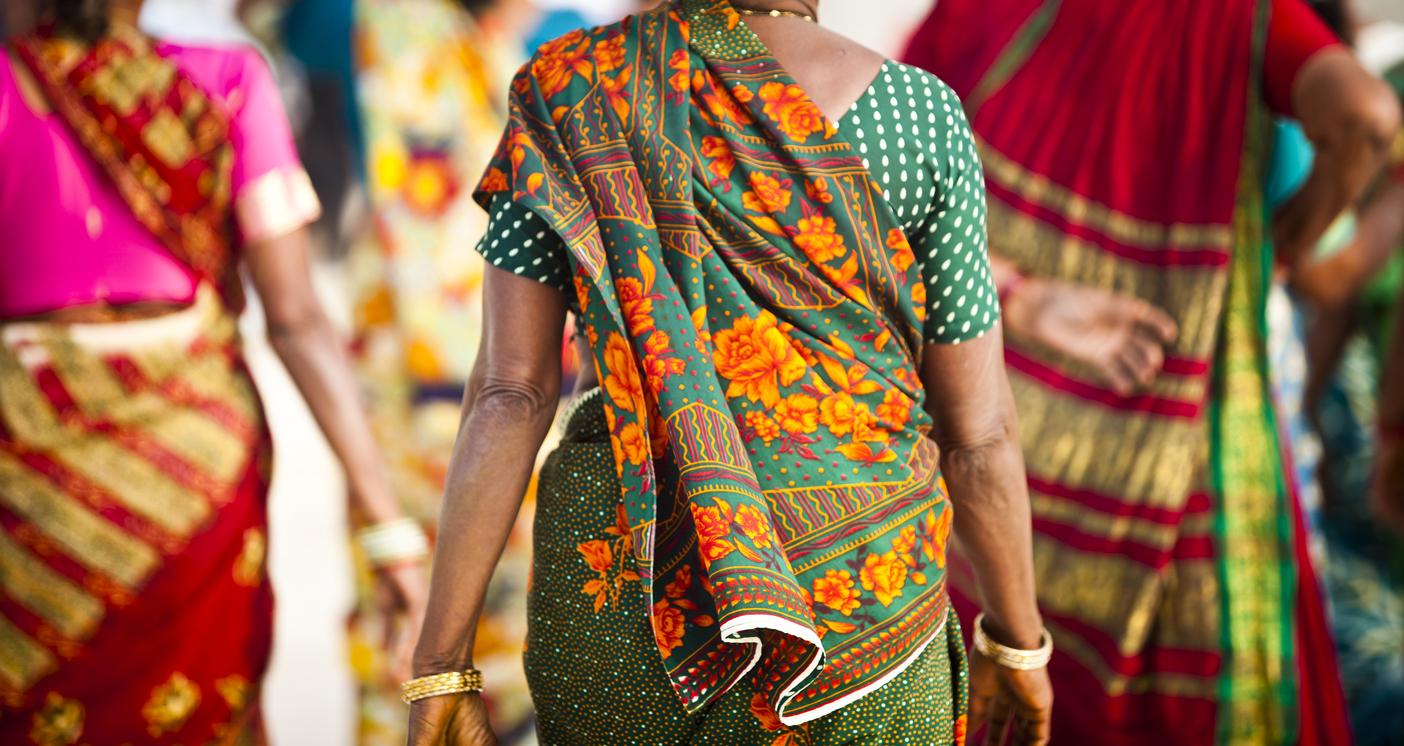 Indian Women dressed in colorful saris at the Taj Mahalhttp://refer.istockphoto.com/traffic_record.php?lc=056905042431004653&atid=6683%7CBannerID%3D6683%7CReferralMethod%3DLink