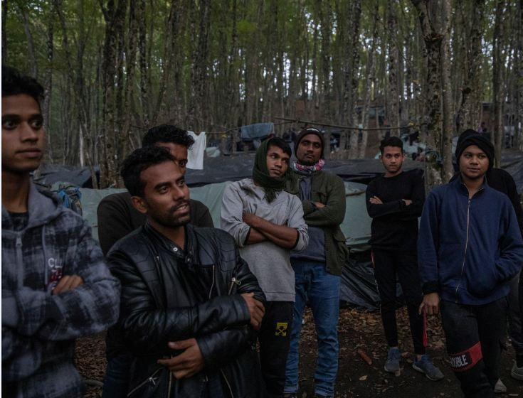 Migrants from Bangladesh stand in the woods near Velika Kladusa, Bosnia and Herzegovina, September 30, 2020. Hundreds of migrants from Asia, the Middle East and North Africa set up makeshift camps in Bosnian woods near the border with Croatia, attempting to cross into the European Union where they hope for a better life. REUTERS/Marko Djurica
