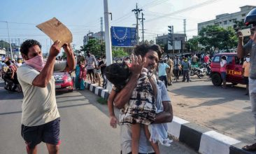 INDIA - FILE PHOTO: A man carries a fainted young girl (R) to evacuate her following a gas leak incident at an LG Polymers plant in Visakhapatnam on May 7, 2020. - Eleven people were killed and hundreds hospitalised after a pre-dawn gas leak at a chemical plant in eastern India on May 7 that left unconscious victims lying in the streets, authorities said. (Photo by STR/AFP via Getty Images)