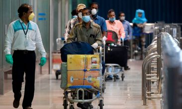 Coronavirus - Indian citizens evacuated from Dubai by Air India flight, arrive at the Anna International Airport as part of a massive repatriation effort due to the COVID-19 coronavirus pandemic, in Chennai on May 9, 2020. (Photo by ARUN SANKAR/AFP via Getty Images)