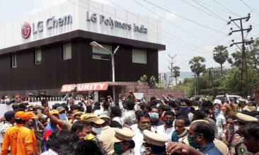 Business - FILE PHOTO: Residents protest in front of LG Polymers plant demanding justice to the gas leak victims, in Visakhapatnam, in Andhra Pradesh state (Photo by STR/AFP via Getty Images)