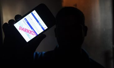HEADLINE STORY - A Sri Lankan man mobile phone user shows an image on Twitter showing that the Facebook site had been blocked in Colombo on March 7, 2018. (Photo by ISHARA S. KODIKARA / AFP)