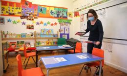 Coronavirus - Head teacher Charlotte Beyazian places plastic bags containing materials on the tables for each pupil to help provide a teaching environment safe from coronavirus for pupils and teachers at La Petite Ecole Bilingue at Kentish Town, north London.(Photo: ISABEL INFANTES/AFP via Getty Images)