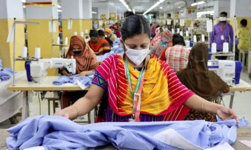 News - A woman works in a garment factory, as factories reopened after the government has eased the restrictions amid concerns over coronavirus disease (COVID-19) outbreak in Dhaka, Bangladesh, May 3, 2020. REUTERS/Mohammad Ponir Hossain
