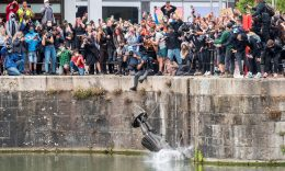HEADLINE STORY - FILE PHOTO: Anti-racism protesters push the statue of 17th century slave trader Edward Colston into the waters near the Bristol harbour. (Keir Gravil via REUTERS)