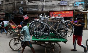 BANGLADESH - Men pull a cart loaded with bicycles in a bicycle market in Dhaka on June 16, 2020. (Photo by MUNIR UZ ZAMAN/AFP via Getty Images)