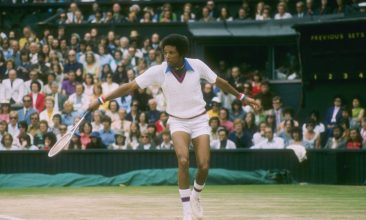 Arts and Culture - Arthur Ashe during a match at Wimbledon in England
