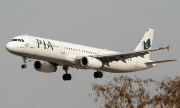 HEADLINE STORY - FILE PHOTO: A Pakistan International Airlines (PIA) plane prepares to land at Islamabad airport in Islamabad February 24, 2007. REUTERS/Faisal Mahmood/File Photo