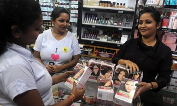 News - An Indian employee of a costemic shop displays L'oreal products in Siliguri on September 15,2012. Indian newspapers hailed September 15 a 'rush of reforms' unveiled by the government which has thrown open the retail and aviation sectors as well as tackled fuel subsidies in highly contentious moves. Shopkeepers, opposition parties and even an ally in the national coalition opposed the move on the grounds that it would destroy the livelihoods of the small business owners who dominate the retail sector. AFP PHOTO/Diptendu DUTTA        (Photo credit should read DIPTENDU DUTTA/AFP/GettyImages)