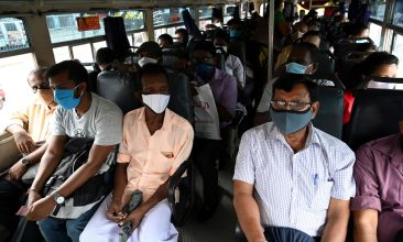 News - Commuters wearing facemasks travel in a bus in Colombo on May 26, 2020 as authorities eased the 24-hour curfew as a preventive measure against the spread of the COVID-19 coronavirus after 67 days. - The 24-hour curfew first imposed on March 20 was eased on May 26 and turned into a night-time curfew as the authorities announced that the spread of the coronavirus was largely under control. (Photo by Ishara S. KODIKARA / AFP) (Photo by ISHARA S. KODIKARA/AFP via Getty Images)