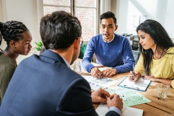 HEADLINE STORY - Multi ethnic group of Millennial investors planning new gainful activity