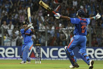 CRICKET - Indian captain Mahendra Singh Dhoni (L) hits a six to win against Sri Lanka as teammate Yuvraj Singh reacts during the Cricket World Cup 2011 final at The Wankhede Stadium in Mumbai on April 2, 2011. India beat Sri Lanka by six wickets. (Photo: INDRANIL MUKHERJEE/AFP via Getty Images)