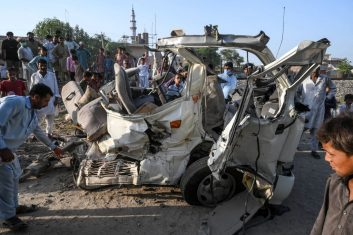 News - Residents gather around the wreckage of a van alongside a railway track following the accident between a train and the van transporting Sikh pilgrims in Farooqabad area in Sheikhupura district of the Pakistan's Punjab province on July 3, 2020. (Photo by ARIF ALI/AFP via Getty Images)