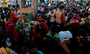 Coronavirus - People wait to board a special train to Rajasthan after the government eased a nationwide lockdown imposed as a preventive measure against the COVID-19 coronavirus, at MGR Central railway station in Chennai on July 9, 2020. (Photo by ARUN SANKAR/AFP via Getty Images)