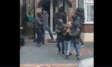 HEADLINE STORY - Screen-grab from a video showing armed police arresting a terror suspect in Ilford.