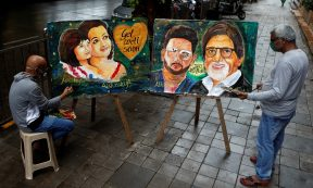 Entertainment - Artists create paintings depicting Bollywood actor Amitabh Bachchan, his son Abhishek Bachchan, his daughter-in-law Aishwarya Rai Bachchan and his granddaughter Aaradhya, after they tested positive for the coronavirus disease (COVID-19), in Mumbai, India, July 13, 2020. REUTERS/Francis Mascarenhas NO RESALES. NO ARCHIVES