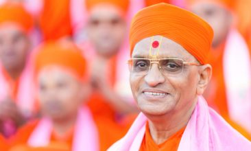 HEADLINE STORY - His Divine Holiness Acharya Swamishree Purushottampriyadasji Maharaj was the fifth heir in the lineage of ascetic Acharyas, who descend directly from Lord Shree Swaminarayan.