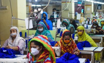 FEATURES - Labourers wearing facemasks work in a garment factory during a government-imposed lockdown as a preventive measure against the spread of the COVID-19 coronavirus in Dhaka on May 2, 2020. (Photo by MUNIR UZ ZAMAN / AFP) (Photo by MUNIR UZ ZAMAN/AFP via Getty Images)