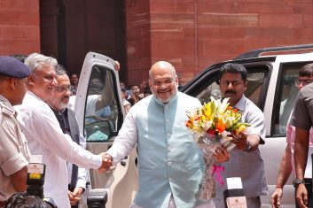 Coronavirus - India's Home Minister Amit Shah receives a flower bouquet upon his arrival at the home ministry in New Delhi, India, June 1, 2019. REUTERS/Altaf Hussain/File Photo