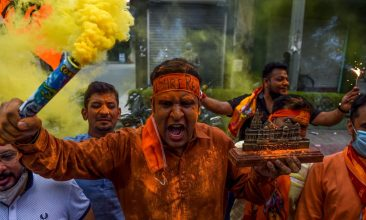 Ayodhya - Bharatiya Janata Party (BJP) activists and supporters shout slogans as they celebrate before the groundbreaking ceremony of the Ram Temple in Ayodhaya, in New Delhi on August 5, 2020. (Photo by MONEY SHARMA/AFP via Getty Images)
