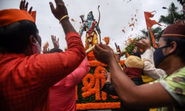 Ayodhya - People from the Hindu and Muslim communities celebrate around a 7-feet tall statue of Lord Ram the foundation stone of a Lord Ram temple in Ayodhya, in Pune on August 5, 2020.  (Photo: SANKET WANKHADE/AFP via Getty Images)