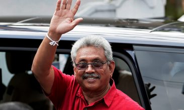 News - Sri Lanka's President Gotabaya Rajapaksa waves at his supporters as he leaves a polling station after casting his vote during the country's parliamentary election in Colombo, Sri Lanka, August 5, 2020. REUTERS/Dinuka Liyanawatte