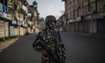 Comment - An Indian paramilitary trooper stands guard on a deserted road in the city center's commercial hub, during a curfew on August 04, 2020  in Srinagar, the summer capital of Indian administered Kashmir, India.  (Photo by Yawar Nazir/Getty Images)