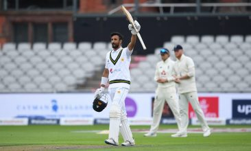 CRICKET - han Masood of Pakistan celebrates reaching his century during Day Two of the 1st #RaiseTheBat Test Match between England and Pakistan at Emirates Old Trafford on August 06, 2020 in Manchester, England. (Photo by Gareth Copley/Getty Images for ECB)