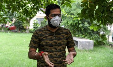 FEATURES - Sarthak Anand wearing a facemask gestures as he speaks during an interview with AFP at his home in Bahadurpur village of Meerut in Uttar Pradesh state. (Photo by PRAKASH SINGH/AFP via Getty Images)