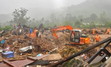 HEADLINE STORY - Rescue workers look for survivors at the site of a landslide during heavy rains in Idukki, Kerala, India, August 7, 2020. REUTERS/Stringer